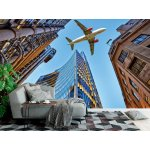 Wall mural jet plane flying over skyscrapers