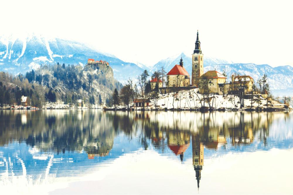 Wallpaper Mural Sunrise at the Lake Bled in Winter (slovenia)