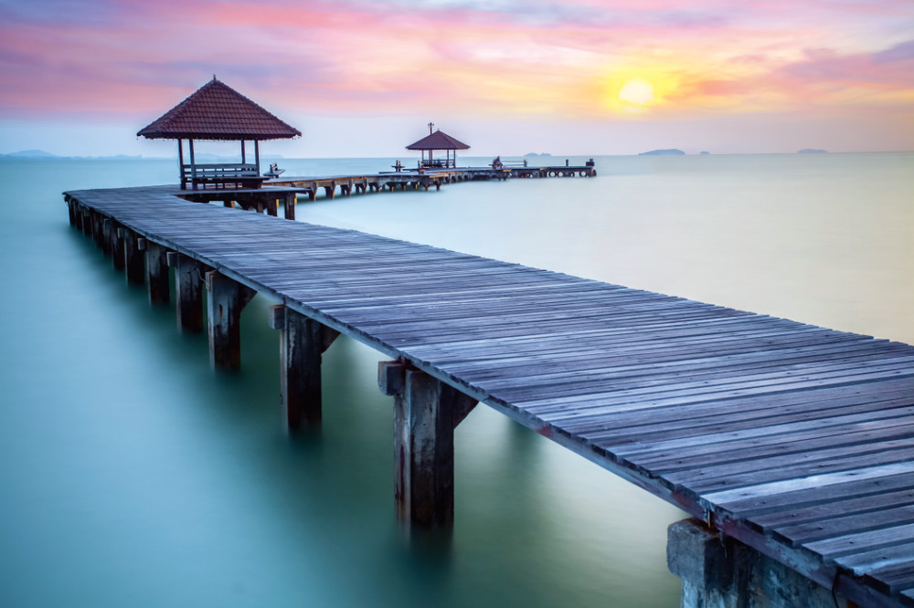 Wall mural wooden jetty and sunrise